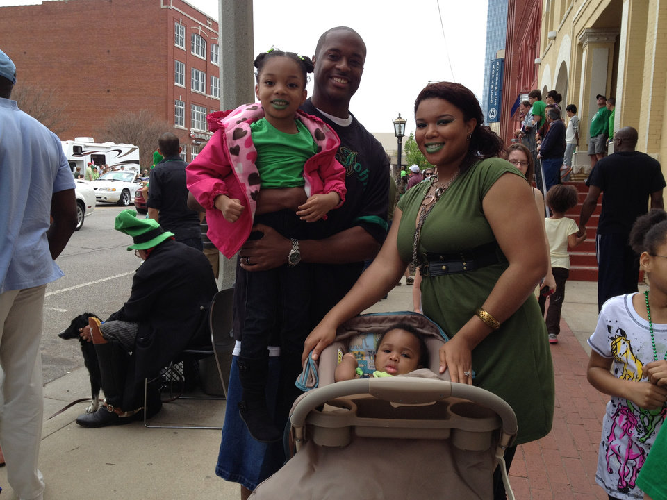 The Hampton family, from left, Janyah Hampton, 4, Jamarl Hampton, Jaydah Hampton, 8 months and Cachet Hampton attend the 30th annual Oklahoma City St. Patrick's Day Parade on Saturday, March 17, 2012. The family lives at Tinker Air Force Base. Jamarl is a military training leader and Cachet is a two-time Iraq War veteran. Photo by Juliana Keeping, The Oklahoman