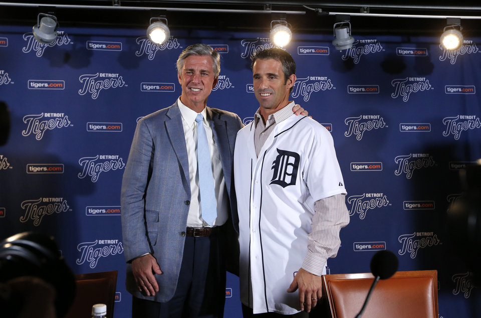 Photo - Detroit Tigers general manager David Dombrowski, left, introduces Brad Ausmus as the new Detroit Tigers manager during a news conference in Detroit Sunday, Nov. 3, 2013. Ausmus replaces Jim Leyland who stepped down as manager. AP Photo/Paul Sancya)