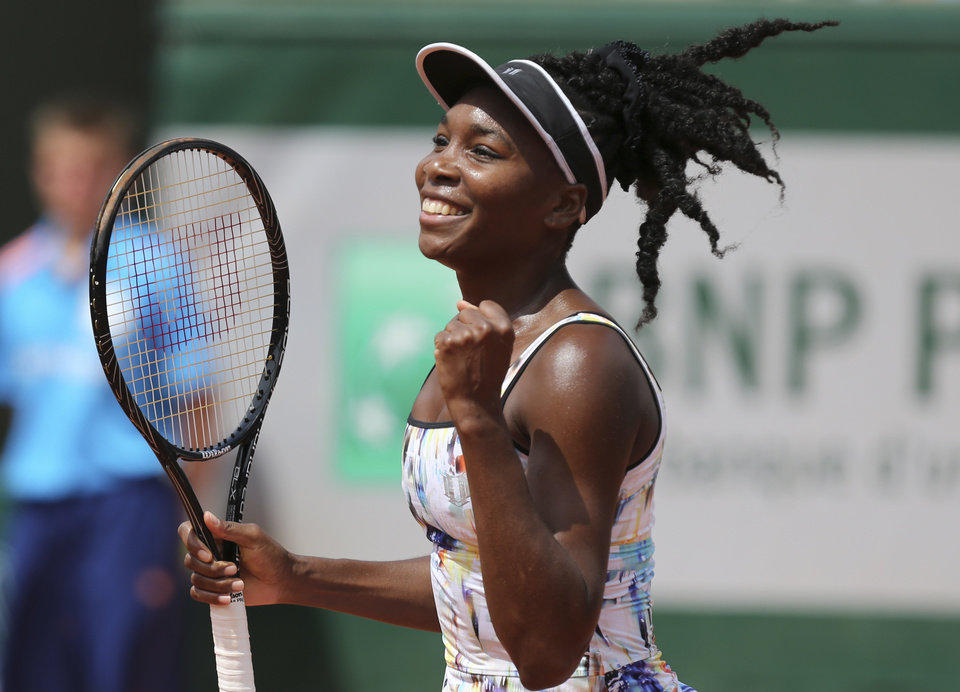 Photo - Venus Williams of the U.S, reacts after defeating Switzerland's Belinda Bencic in the first round match of  the French Open tennis tournament at the Roland Garros stadium, in Paris, France, Sunday, May 25, 2014. Williams won 6-4, 6-1.  (AP Photo/David Vincent)