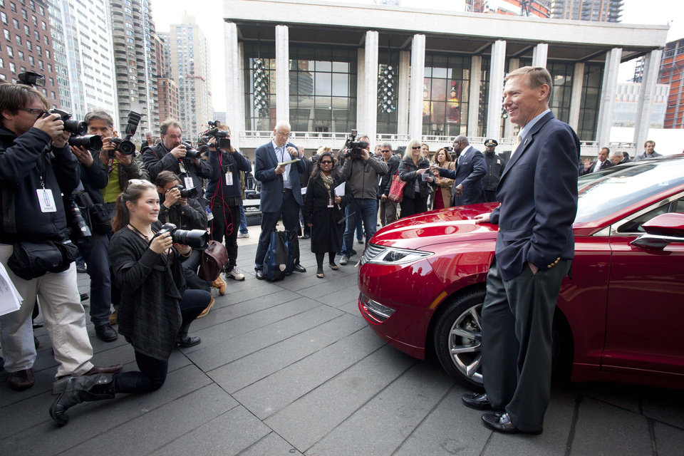 Photo - Ford Motor Co. President and CEO Alan Mulally, stands next to a Lincoln MKZ as he poses for photographers, Monday, Dec. 3, 2012 in New York. The MKZ will arrive at dealerships this month. The MKZ is the first of seven new or revamped Lincolns that will go on sale by 2015. (AP Photo/Mark Lennihan)