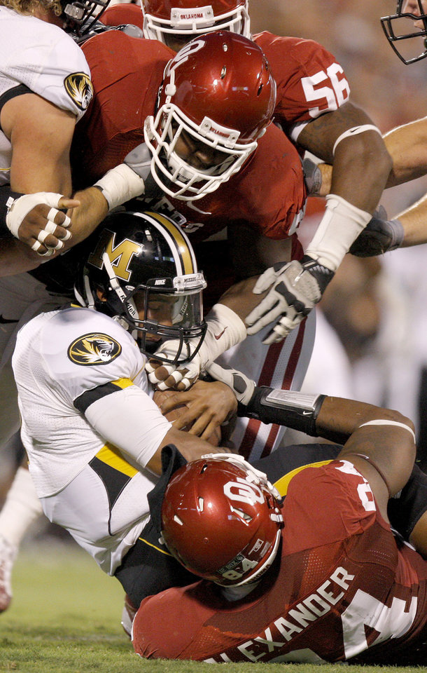 Oklahoma's Jamarkus McFarland (97) and Frank Alexander (84) bring down Missouri's James Franklin (1) during their game Saturday in Norman.Photo by Bryan Terry, The Oklahoman