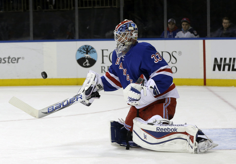 Photo - New York Rangers goalie Cam Talbot blocks a shot on goal during the first period of an NHL hockey game against the Minnesota Wild, Sunday, Dec. 22, 2013, in New York. (AP Photo/Seth Wenig)