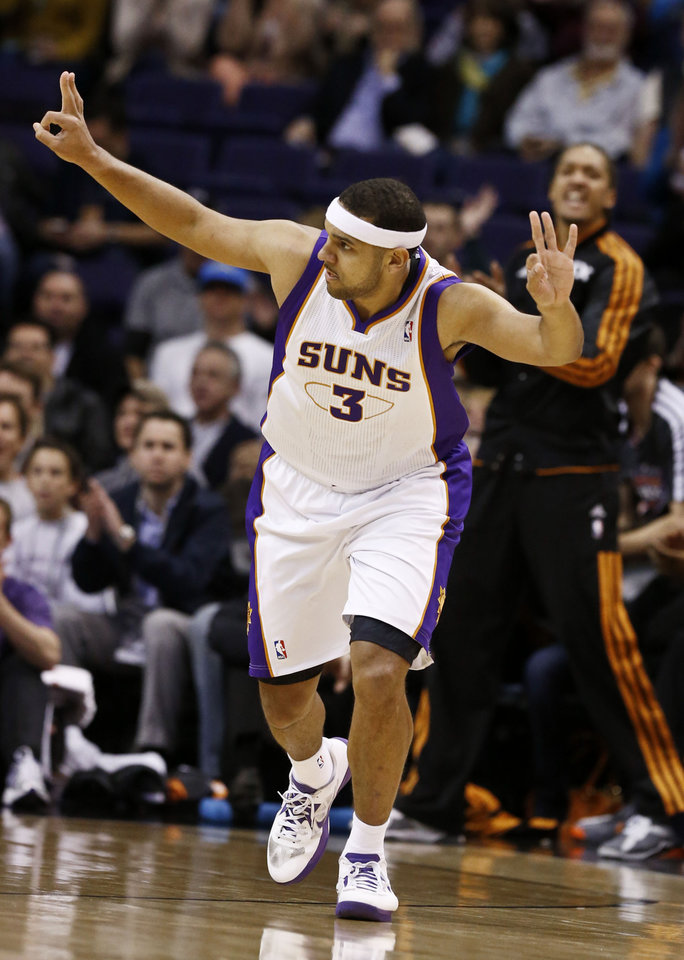 Phoenix Suns' Jared Dudley (3) celebrates a three-point basket against the Philadelphia 76ers during the first half of an NBAbasketball game on Wednesday, Jan. 2, 2013, in Phoenix. (AP Photo/Ross D. Franklin)