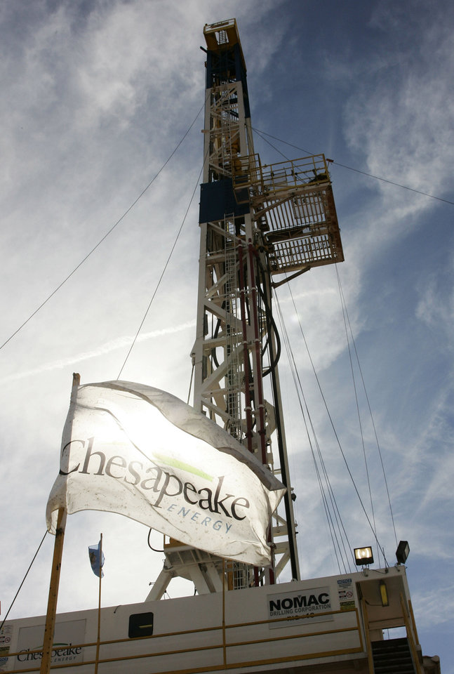 Photo - A Chesapeake drilling rig is shown Oct. 28, 2009, near Bessie.  AP Photo