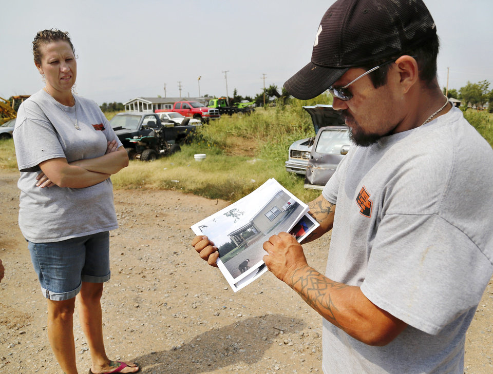 Photo - Jessica Miller, left, and husband,  Jeremy Knox, at their Carney home/business, which were  destroyed in the May 19 tornado. Knox also is on the temporary high risk pool for health insurance due to a serious pre-existing health condition.  Photo  by Jim Beckel, The Oklahoman.
