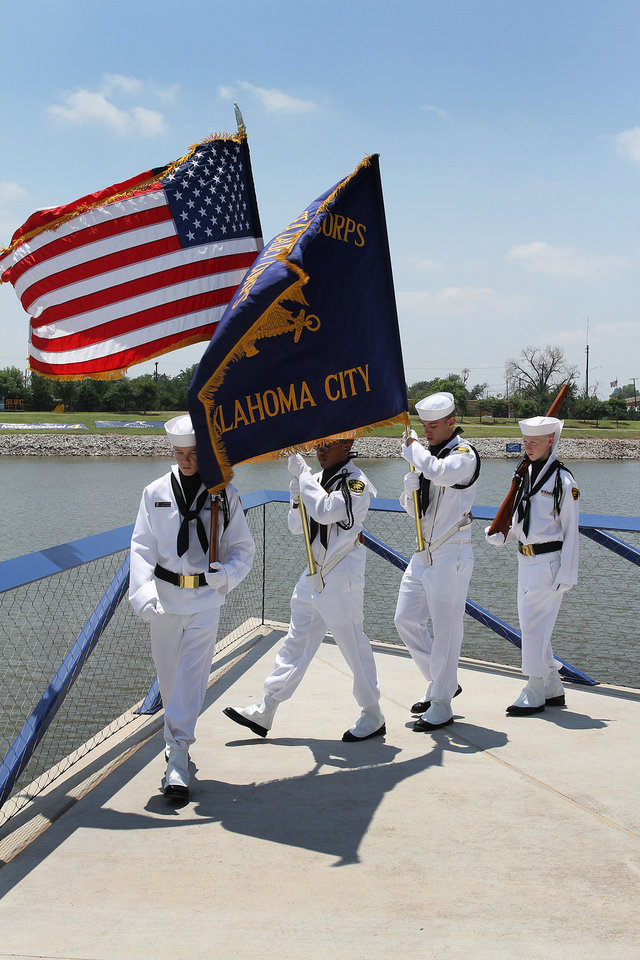 US Naval Sea Cadet Corp members, from let to right, Cyrus Kirkham of Sparks, Cameron Faulkner of Edmond, Kevin Alimi of Shawnee and Alex Wright of Shawnee during the Oklahoma City Nationals Drag Boat races on the Oklahoma River Saturday, June 9th, 2012. PHOTO BY HUGH SCOTT, FOR THE OKLAHOMAN  ORG XMIT: KOD