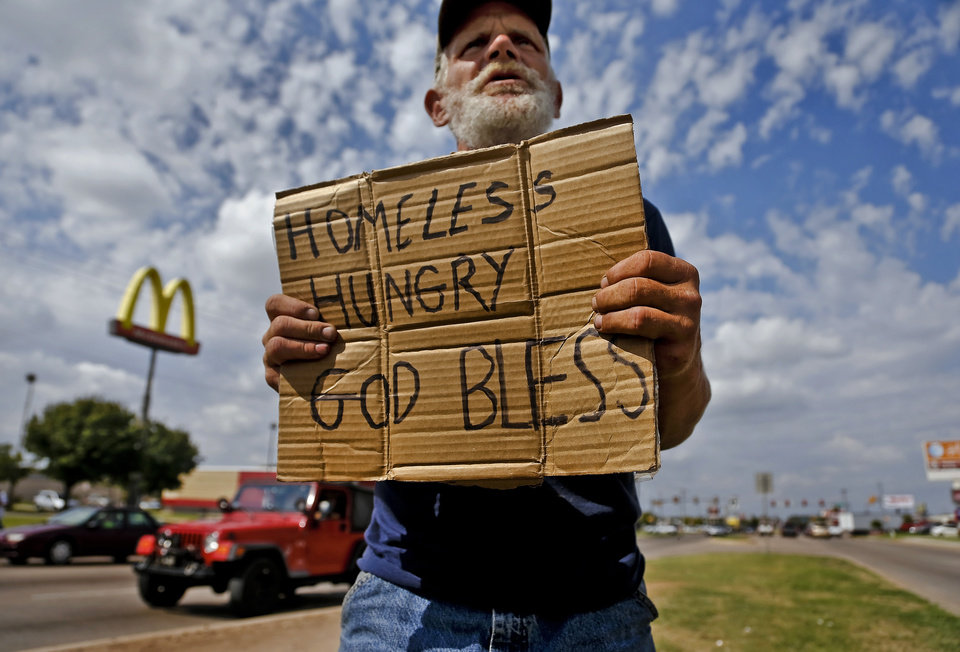 Raymond Hauser, 50, of Joplin, Mo. panhandles as he works the intersection at I-40 and MacArthur Boulevard on Wednesday, Sept. 26, 2012, in Oklahoma City, Okla. Hauser ended up in Oklahoma after being stranded while hitchhiking to California a month ago.  Photo by Chris Landsberger, The Oklahoman