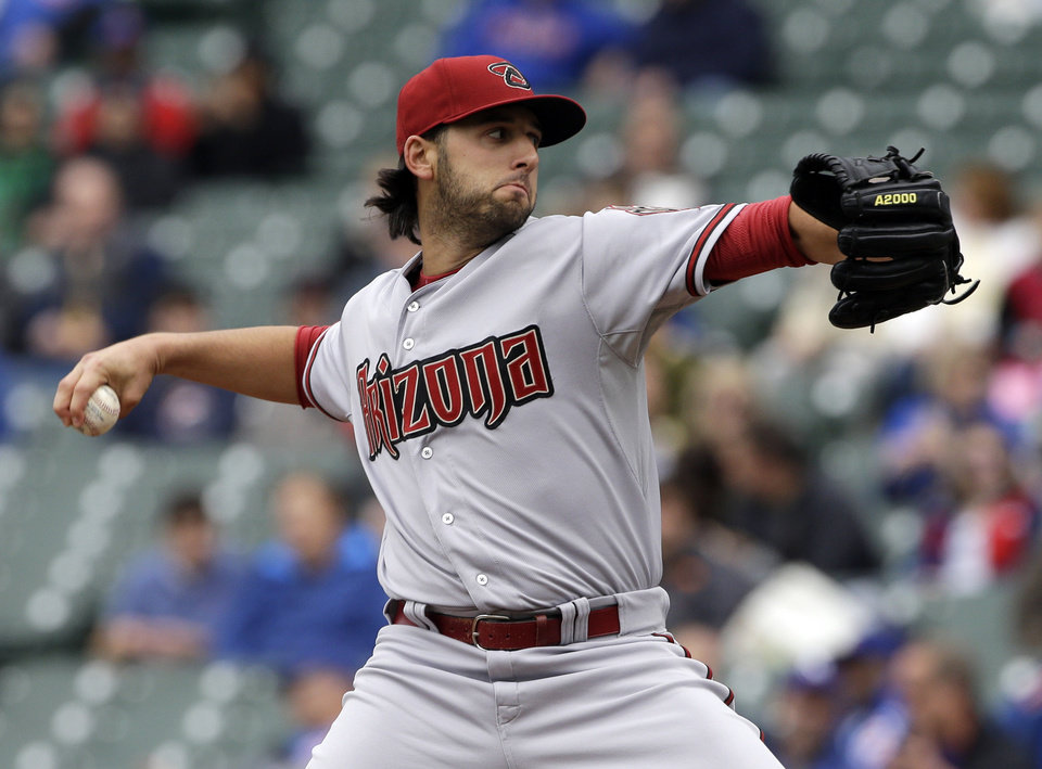 Photo - Arizona Diamondbacks starter Mike Bolsinger throws against the Chicago Cubs during the first inning of a baseball game in Chicago, Thursday, April 24, 2014. (AP Photo/Nam Y. Huh)