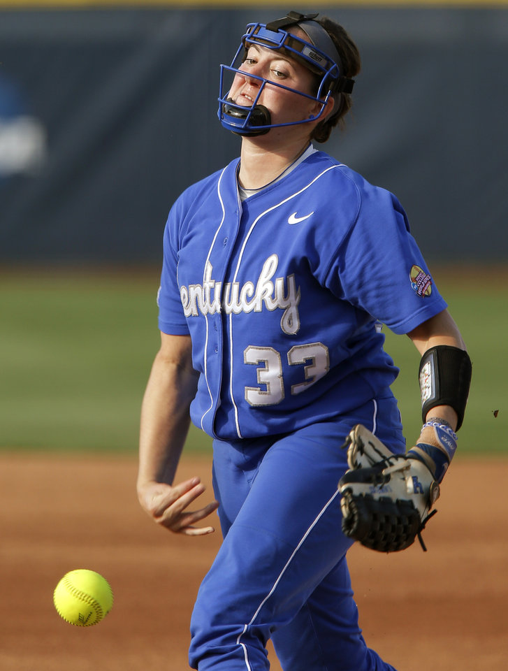 Photo - Kentucky's Kelsey Nunley (33) pitches during a Women's College World Series game between La.-Lafayette and Kentucky at ASA Hall of Fame Stadium in Oklahoma City Thursday, May 29, 2014. Photo by Bryan Terry, The Oklahoman