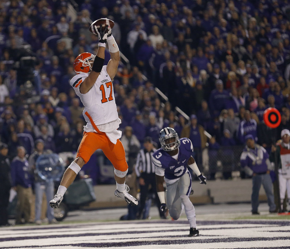 Photo - Oklahoma State's Charlie Moore (17) catches a touchdown pass in front of Kansas State's Allen Chapman (3) in the fourth quarter of the college football game between Kansas State University (KSU) and Oklahoma State (OSU) at  Bill Snyder Family Football Stadium in Manhattan, Kan.,  Saturday, Nov. 3, 2012. Photo by Sarah Phipps, The Oklahoman