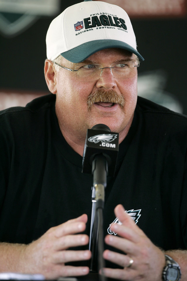 Photo - FILE - This July 30, 2011 file photo shows Philadelphia Eagles head coach Andy Reid talking with the media after the morning session at NFL football training camp at Lehigh University in Bethlehem, Pa. Reid arrived in Kansas City on Friday, Jan. 4, 2012, and the Chiefs are close to making an official announcement that he will become their next coach. (AP Photo/Rich Schultz, File)