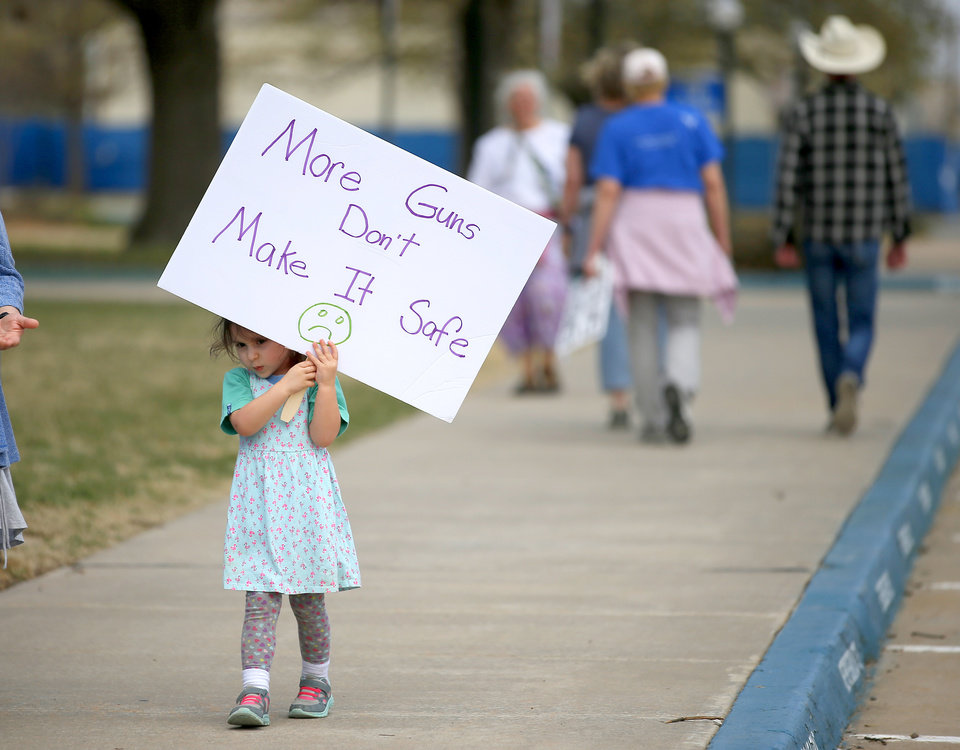 "Photo - Lucia Crookes holds a sign outside the state Capitol during a ""March for Our Lives"" rally in support of gun control in Oklahoma City, Saturday, March 24, 2018. Photo by Bryan Terry, The Oklahoman"