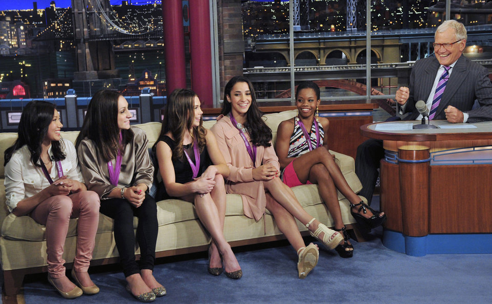 """Photo -   In this photo provided by CBS, from left, Kyla Ross, Jordyn Wieber, McKayla Maroney, Aly Raisman and Gabby Douglas, members of the United States women's Olympic gymnastics gold medal-winning team, join television show host David Letterman on the set of the """"Late Show with David Letterman,"""" Tuesday, Aug. 14, 2012, in New York. (AP Photo/CBS, John Paul Filo) MANDATORY CREDIT; NO SALES; NO ARCHIVE; FOR NORTH AMERICAN USE ONLY"""