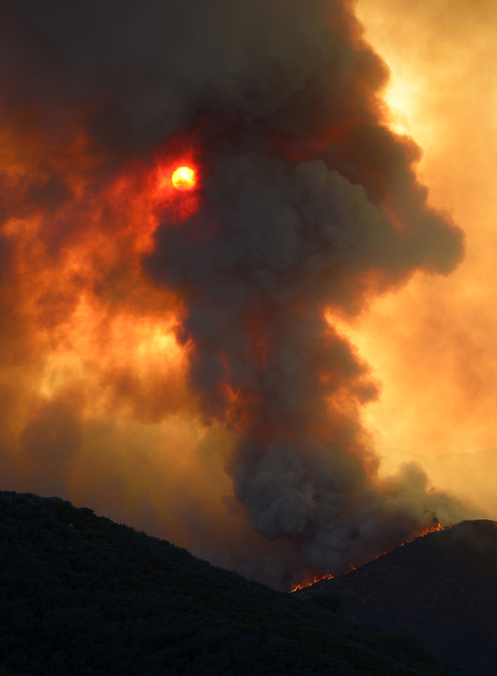 Photo - Smoke billows from a fire burring in Point Mugu State Park during a wildfire that burned several thousand acres, Thursday, May 2, 2013, in Ventura County, Calif.   (AP Photo/Mark J. Terrill)