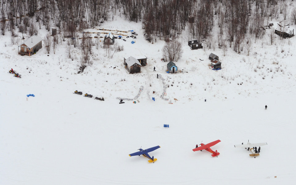 Photo - The lead group of Iditarod Trail Sled Dog Race mushers rest their dog teams in a wooded area at the historic checkpoint of Iditarod, Alaska, on Thursday, March 7, 2013. (AP Photo/Anchorage Daily News, Bill Roth)