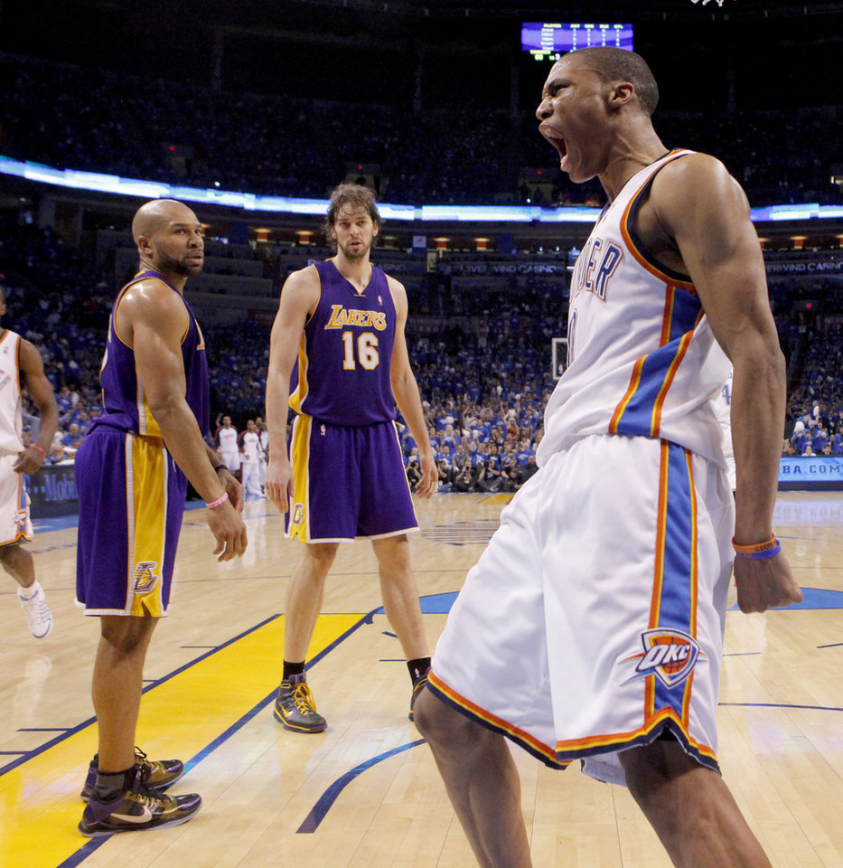 Oklahoma City's Russell Westbrook celebrates after a dunk as Derek Fisher, left, and Pau Gasol of the Lakers watch during the NBA basketball game between the Los Angeles Lakers and the Oklahoma City Thunder in the first round of the NBA playoffs at the Ford Center in Oklahoma City, Thursday, April 22, 2010. Photo by Bryan Terry, The Oklahoman