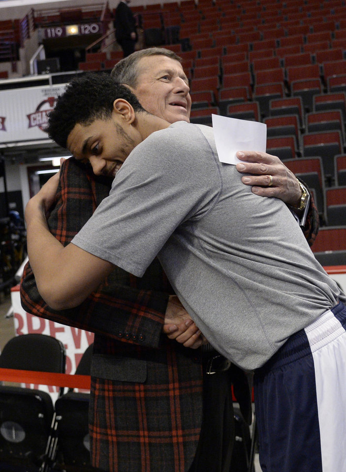 Photo - Craig Sager, left, gets a hug from Oklahoma City Thunder guard Jeremy Lamb, right, before the game between the Chicago Bulls and the Oklahoma City Thunder. Sager returns to broadcasting as a sideline reporter for TNT tonight at the Bulls game in Chicago. He's been out all season recovering from leukemia, Thursday, March 5, 2015. (AP Photo/David Banks)