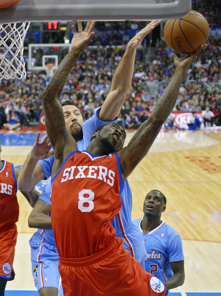 Photo - Philadelphia 76ers guard Tony Wroten, right, puts up a shot as Los Angeles Clippers forward Hedo Turkoglu, of Turkey, defends during the first half of an NBA basketball game, Sunday, Feb. 9, 2014, in Los Angeles. (AP Photo/Mark J. Terrill)