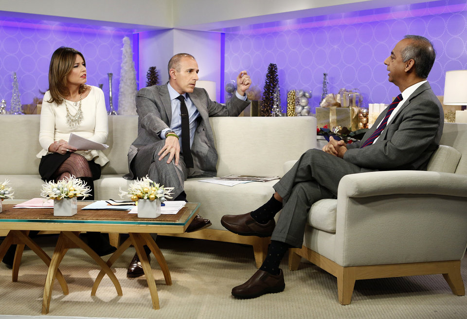 Photo - This image released by NBC shows co-hosts Savannah Guthrie, left, and Matt Lauer, center, during an interview with freelance photographer R. Umar Abbasi on NBC News'