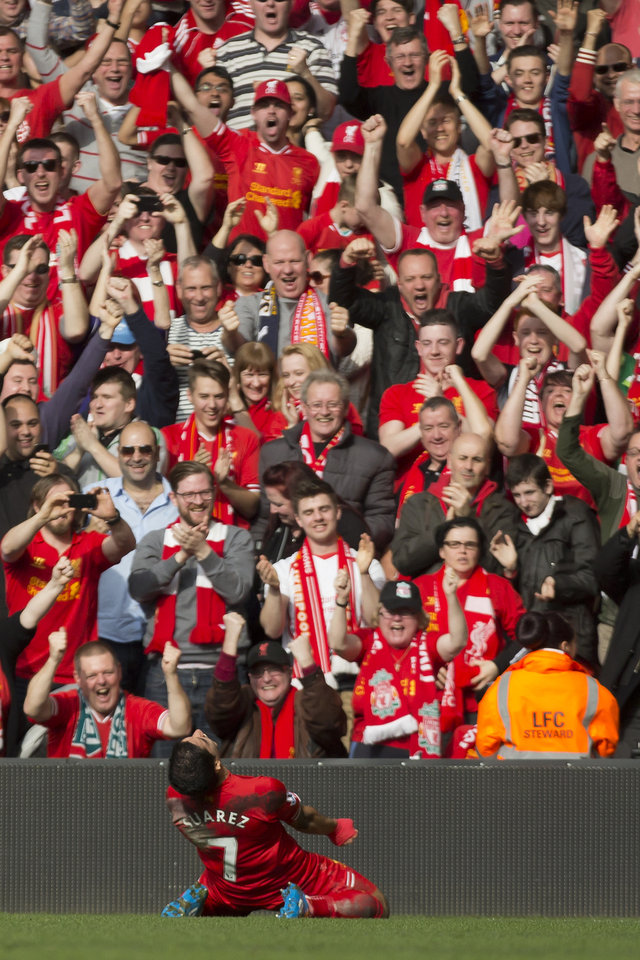 Photo - Liverpool's Luis Suarez celebrates with fans after scoring against Tottenham during their English Premier League soccer match at Anfield Stadium, Liverpool, England, Sunday March 30, 2014. (AP Photo/Jon Super)