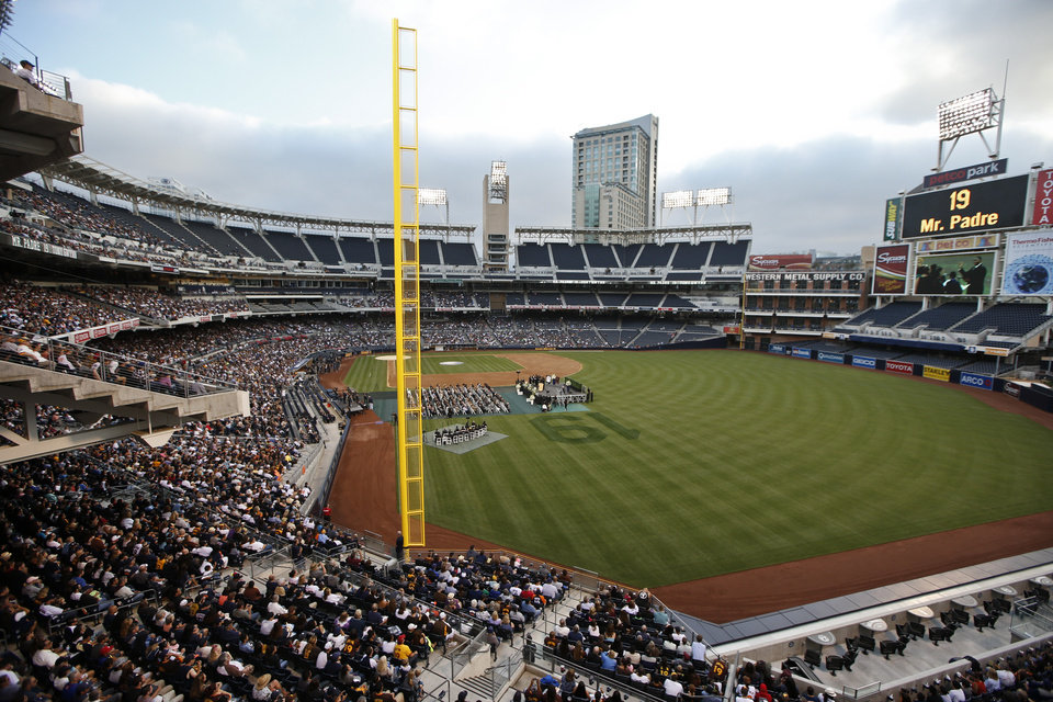 Photo - Fans fill the right field stands at Petco Park for a memorial service Thursday, June 26, 2014, in San Diego for Hall of Fame baseball player Tony Gwynn, who died June 16 from cancer at the age of 54. Gwynn, who won eight batting titles and had a career .338 batting average, played his entire 20 year career for the San Diego Padres. (AP Photo/Lenny Ignelzi)