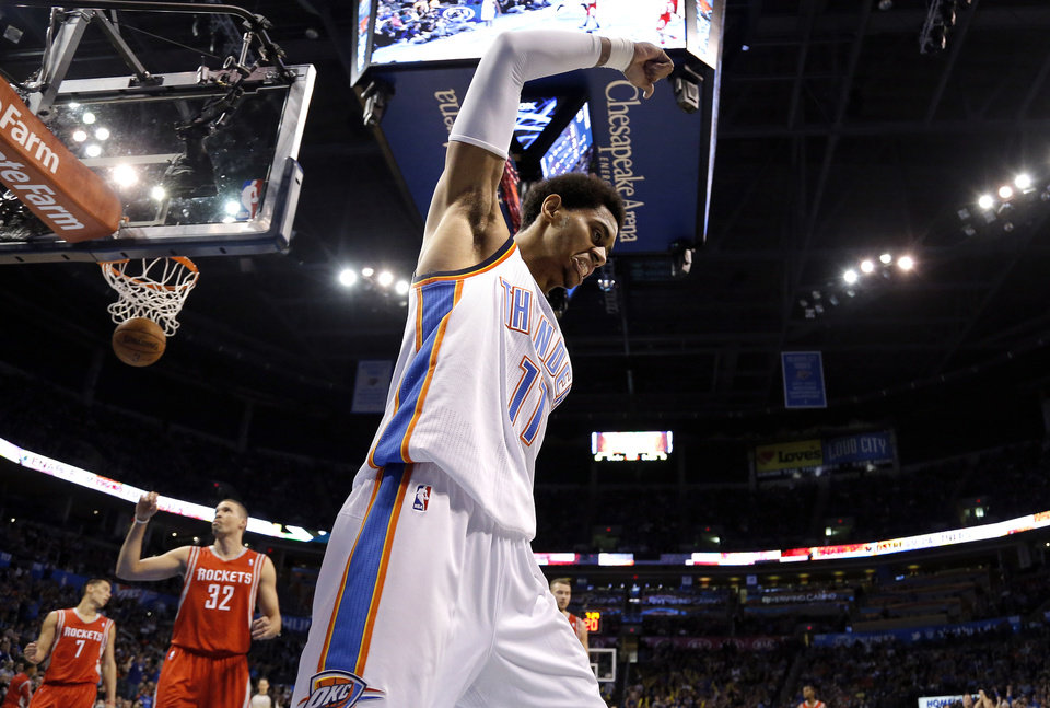 Photo - Oklahoma City 's Jeremy Lamb (11) celebrates a basket during the NBA game between the Oklahoma City Thunder and the Houston Rockets at the Chesapeake Energy Arena  in Oklahoma City, Sunday, Dec. 29, 2013. Photo by Sarah Phipps, The Oklahoman