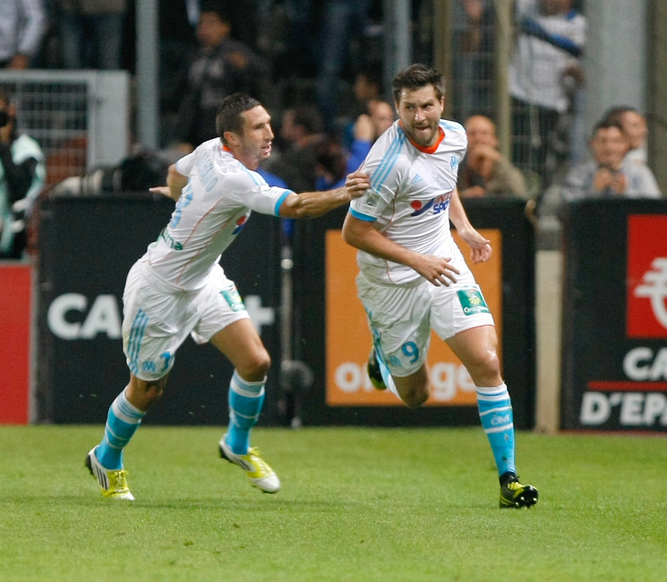 Photo -   Marseille's French forward Andre-Pierre Gignac, right, reacts with Marseille's French midfielder Morgan Amalfitano, after scoring against Paris Saint-Germain, during their League One soccer match, in Marseille, southern France, Sunday, Oct. 7, 2012. (AP Photo/Claude Paris)
