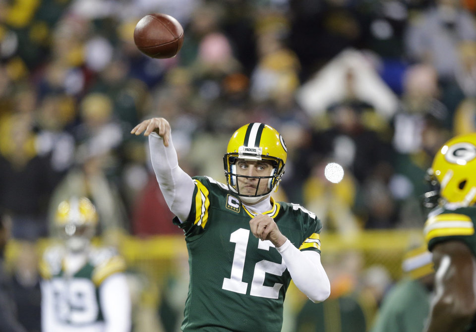 Photo - Green Bay Packers quarterback Aaron Rodgers warms up before an NFL wild card playoff football game against the Minnesota Vikings Saturday, Jan. 5, 2013, in Green Bay, Wis. (AP Photo/Jeffrey Phelps)