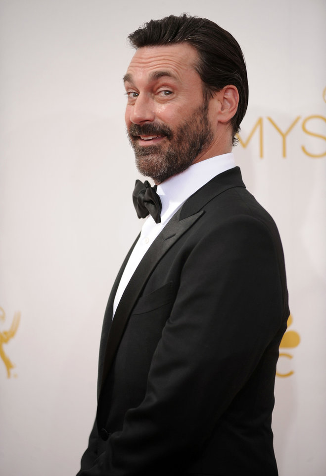 Photo - Jon Hamm arrives at the 66th Annual Primetime Emmy Awards at the Nokia Theatre L.A. Live on Monday, Aug. 25, 2014, in Los Angeles. (Photo by Richard Shotwell/Invision/AP)