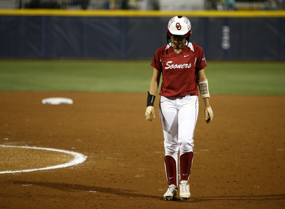 Photo - Oklahoma's Destinee Martinez (0) walks off the field after losing 6-2 in a Women's College World Series game between the University of Oklahoma and Alabama at ASA Hall of Fame Stadium in Oklahoma City Thursday, May 29, 2014. Photo by Bryan Terry, The Oklahoman