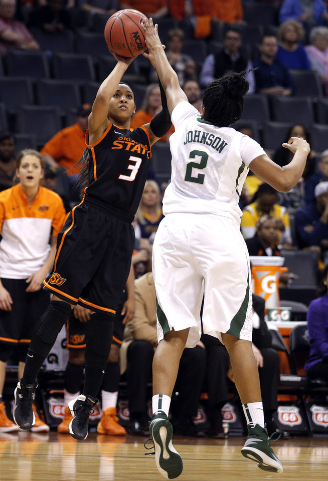 Photo - Oklahoma State's Tiffany Bias (3) shoots as Baylor's Niya Johnson (2) defends during the Women's Big 12 basketball tournament game between Baylor and Oklahoma State at Chesapeake Energy Arena  in Oklahoma City, Okla., Sunday, March 9, 2014. Photo by Sarah Phipps, The Oklahoman