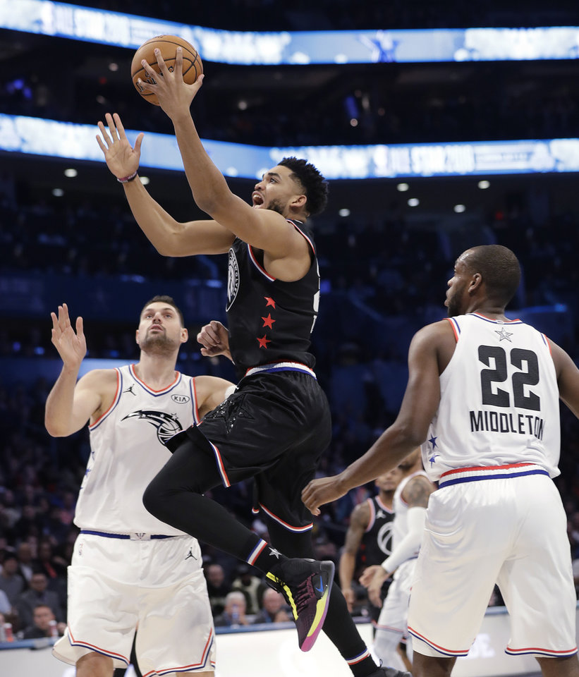 Photo - Team LeBron's Karl-Anthony Towns, of the Minnesota Timberwolve dunks against Team Giannis during the second half of an NBA All-Star basketball game, Sunday, Feb. 17, 2019, in Charlotte, N.C. The Team LeBron won 178-164. (AP Photo/Chuck Burton)