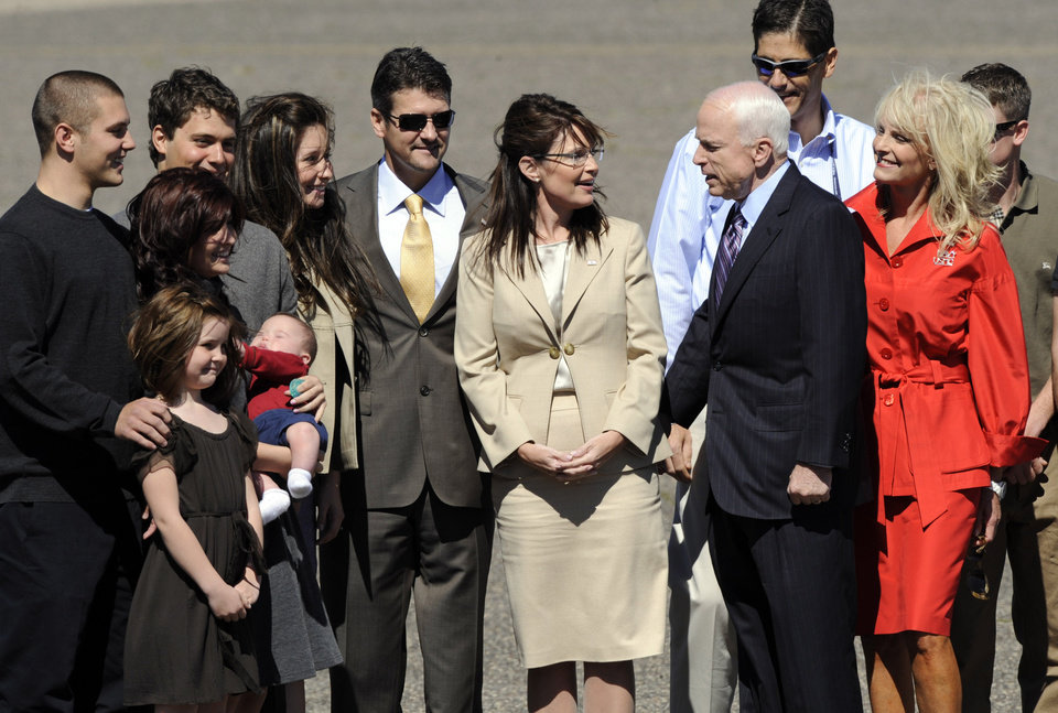 Photo - ** ADDS IDENTIFICATION OF PALIN FAMILY MEMBERS **   Republican presidential candidate Sen. John McCain, R-Ariz., is greeted at the airport by Republican vice presidential candidate Alaska Gov. Sarah Palin, and her family as well as Cindy McCain, right, and family upon his arrival in Minneapolis, Wednesday, Sept. 3, 2008, to attend the Republican National Convention in St. Paul, Minn. From left to right are Track Palin, Piper Palin, Willow Palin, Levi Johnston, Trig Palin, Bristol Palin and Todd Palin. (AP Photo/Susan Walsh) ORG XMIT: MNSW107
