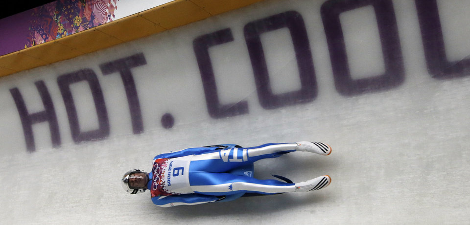 Photo - Armin Zoeggeler of Italy takes a turn on his final run during the men's singles luge final at the 2014 Winter Olympics, Sunday, Feb. 9, 2014, in Krasnaya Polyana, Russia. Zoeggeler won the bronze. (AP Photo/Dita Alangkara)