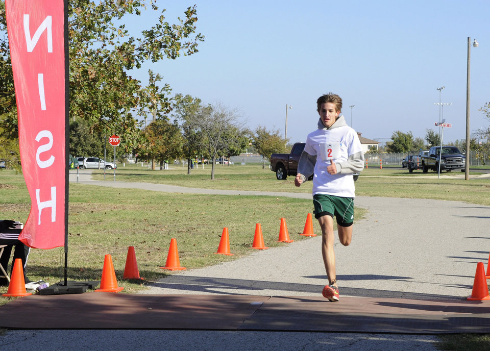 Braeden Arnold wins the 5k at the  AWAC replica dedication in Del  City Saturday. Photo by M. Timothy Blake, for The Oklahoman <strong>M. Tim Blake</strong>