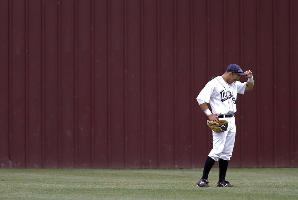 Metro Christian's Connor Drake stands in the outfield as they take on Verdigris during the 3A State Championship baseball game at Edmond Memorial High School on Saturday,  May 12, 2012, in Edmond, Oklahoma. Photo by Chris Landsberger, The Oklahoman