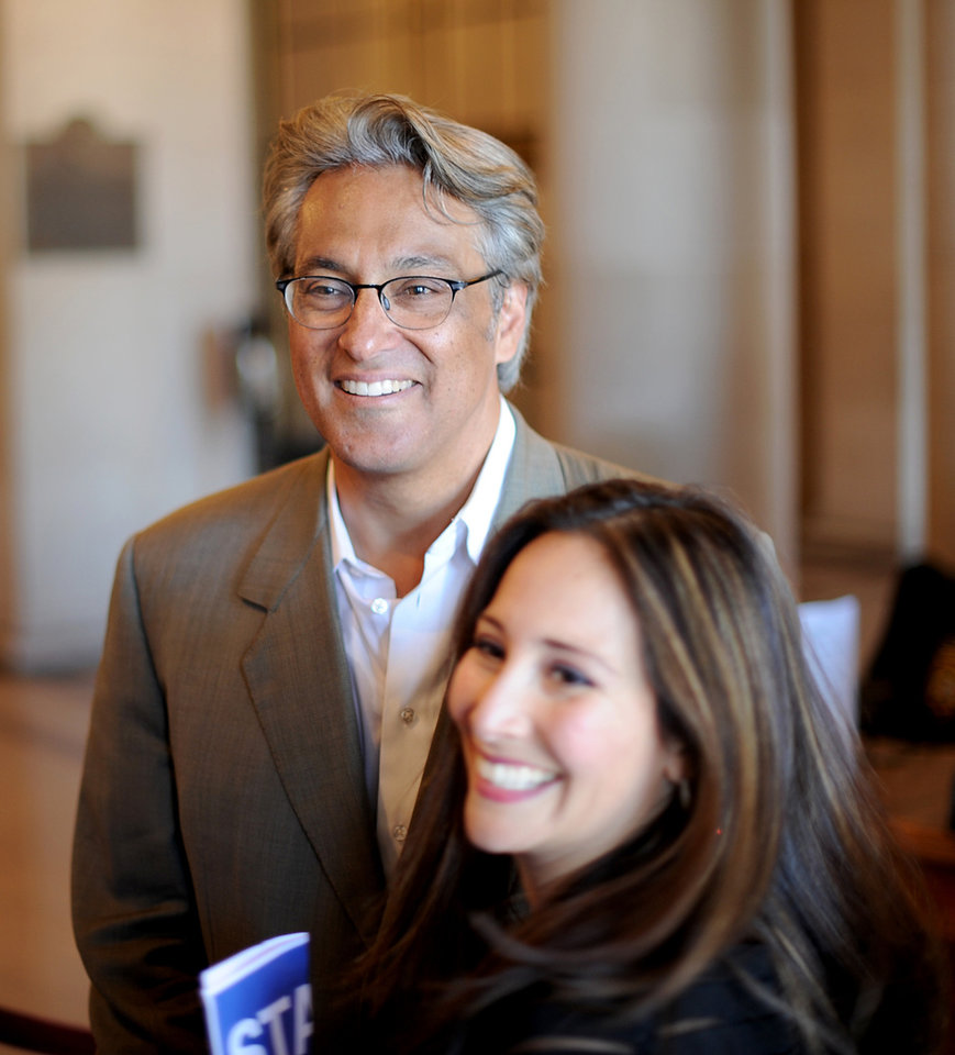 Photo -   Suspended San Francisco Sheriff Ross Mirkarimi and his wife Eliana Lopez arrive at a Board of Supervisors meeting on Tuesday, Oct. 9, 2012, in San Francisco. The Board planned to vote on removing Mirkarimi, who pled guilty to a misdemeanor charge in a domestic violence case, from office. (AP Photo/Noah Berger)