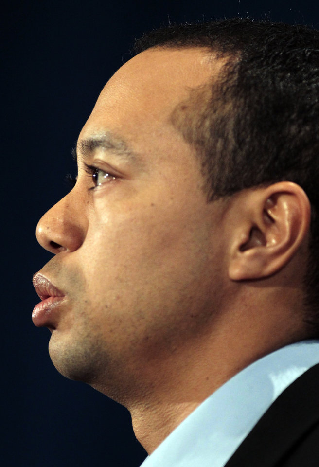 Photo - Tiger Woods makes a statement at the Sawgrass Players Club, Friday, Feb. 19, 2010, in Ponte Vedra Beach, Fla. (AP Photo/Joe Skipper, Pool) ORG XMIT: TWP106