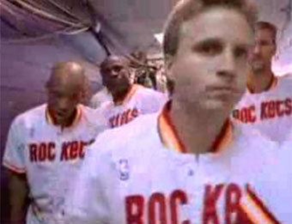 Thunder coach Scott Brooks leads the Houston Rockets out of the tunnel. Over his left shoulder is former Rockets teammate Matt Bullard.