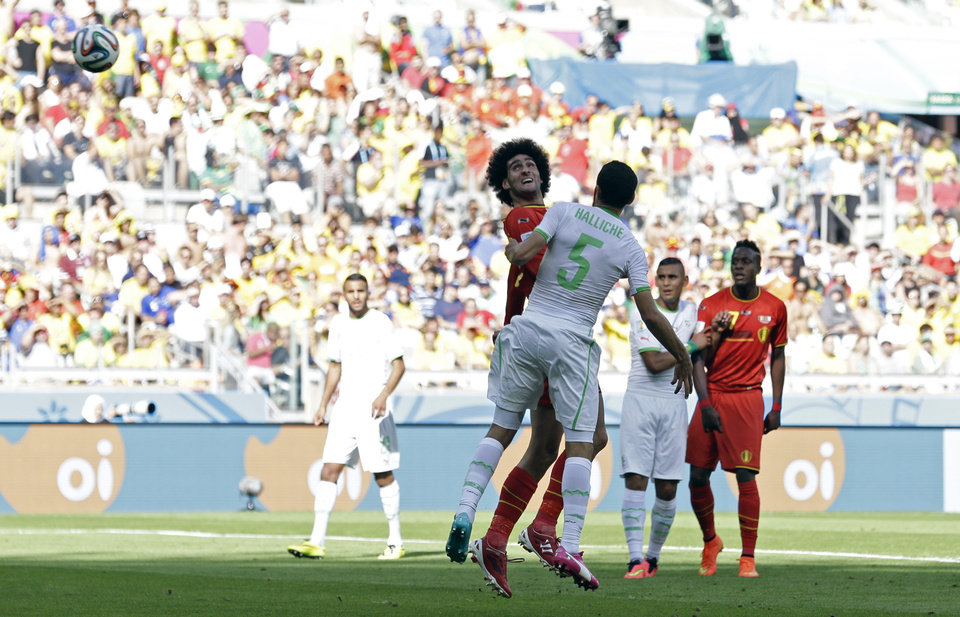 Photo - Belgium's Marouane Fellaini scores his side's first goal during the group H World Cup soccer match between Belgium and Algeria at the Mineirao Stadium in Belo Horizonte, Brazil, Tuesday, June 17, 2014.  (AP Photo/Hassan Ammar)