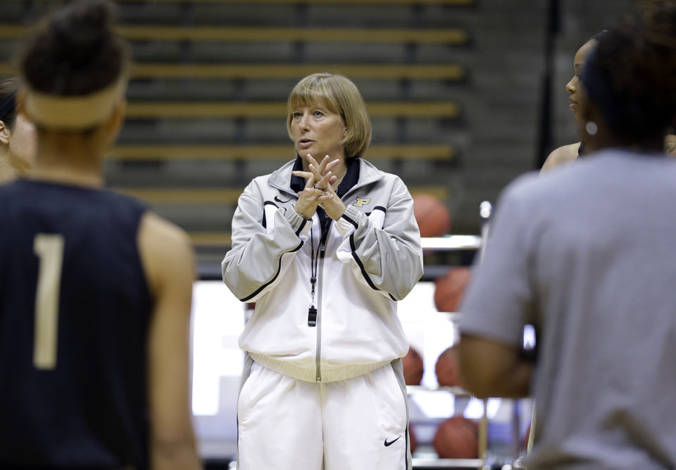 Photo - Purdue head coach Sharon Versyp talks to her team during practice at the NCAA women's college basketball tournament in West Lafayette, Ind., Friday, March 21, 2014.  Purdue plays Akron in a first-round game on Saturday. (AP Photo/Michael Conroy)