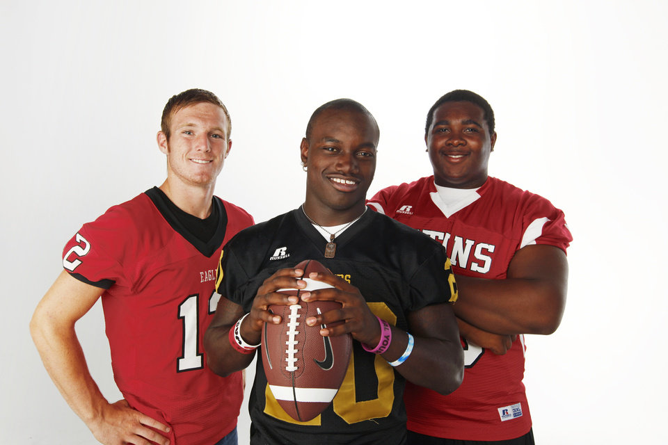 Photo - HIGH SCHOOL FOOTBALL ZONE PREVIEW: From left, Jonathan McBride of Del City, James Flanders of Midwest City and RayShawn Cato of Carl Albert pose for a photo at the OPUBCO studio in Oklahoma City, Saturday, Aug. 20, 2011. Photo by Nate Billings, The Oklahoman ORG XMIT: KOD