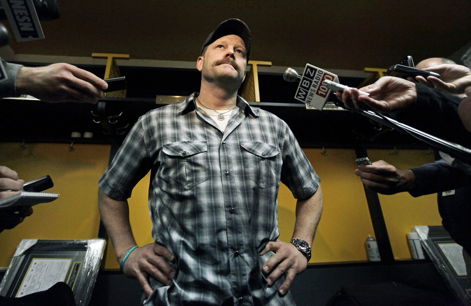 Photo -   Boston Bruins goalie Tim Thomas pauses to speak to reporters in the locker room at TD Garden in Boston, Friday, April 27, 2012, about their loss to the Washington Capitals in Game 7 and the Bruins' elimination from the Stanley Cup hockey playoffs. (AP Photo/Elise Amendola)