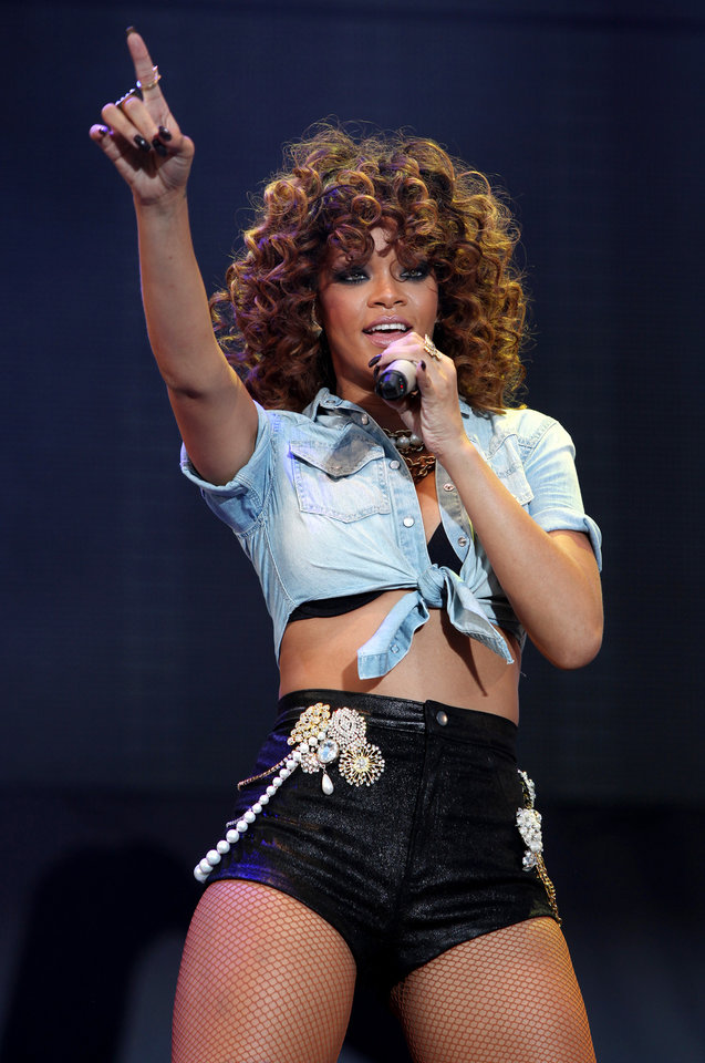 FILE - In this Aug. 21, 2011 file photo, U.S. singer Rihanna performs on stage at the V Music Festival in Hylands Park, London. (AP Photo/Joel Ryan, File)