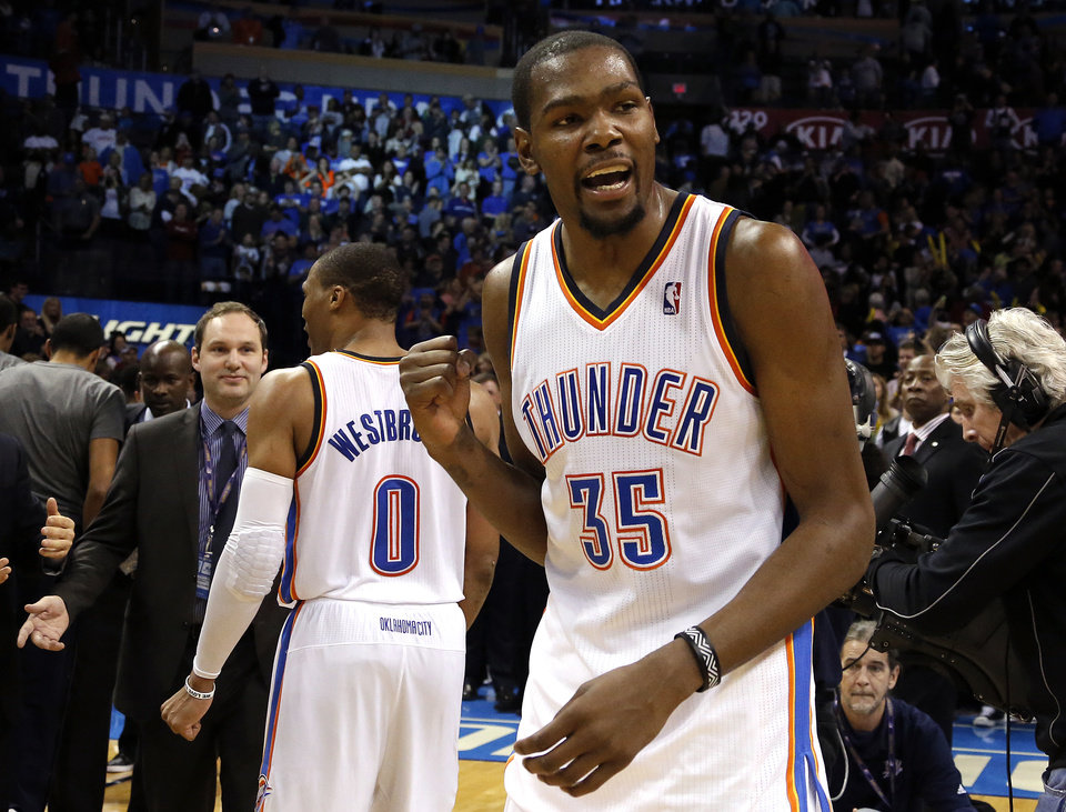 Photo - Oklahoma City's Kevin Durant (35) celebrates the Thunder's overtime win of the NBA game between the Oklahoma City Thunder and the Golden State Warriors at the Chesapeake Energy Arena, Friday, Nov. 29, 2013. Photo by Sarah Phipps, The Oklahoman