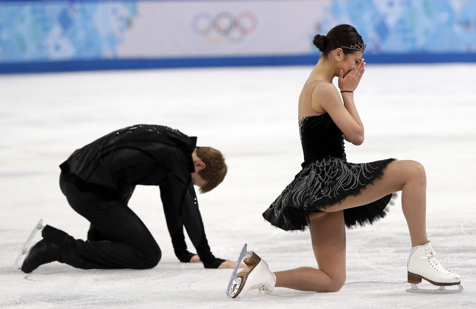 Photo - Elena Ilinykh and Nikita Katsalapov of Russia react as they complete their routine in the ice dance free dance figure skating finals at the Iceberg Skating Palace during the 2014 Winter Olympics, Monday, Feb. 17, 2014, in Sochi, Russia. (AP Photo/Darron Cummings, File)