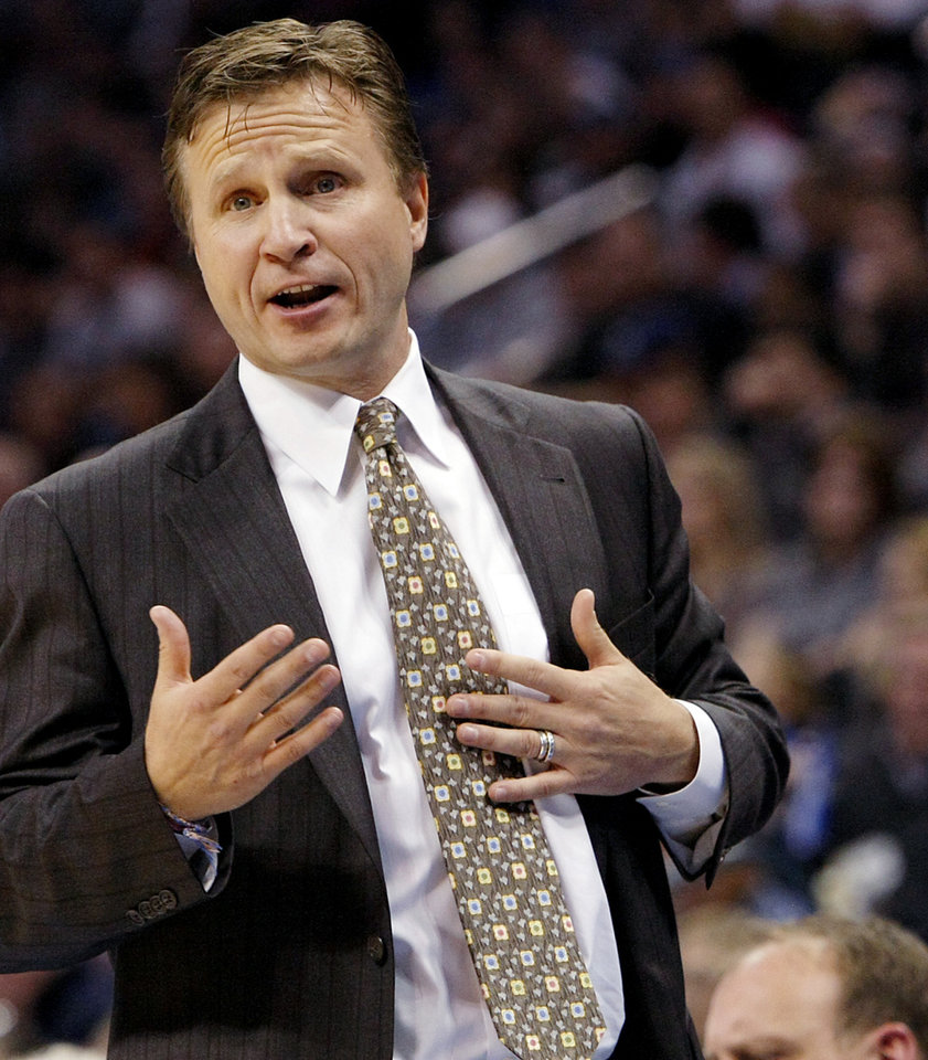 Photo - Oklahoma City's Head Coach Scott Brooks coaches his team against Houston during their NBA basketball game at the OKC Arena in downtown Oklahoma City on Wednesday, Nov. 17, 2010. Photo by John Clanton, The Oklahoman