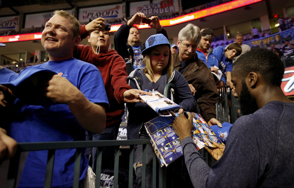 Fans get the autograph of Oklahoma City\'s James Harden before the NBA basketball game between the Denver Nuggets and the Oklahoma City Thunder in the first round of the NBA playoffs at the Oklahoma City Arena, Wednesday, April 27, 2011. Photo by Bryan Terry, The Oklahoman