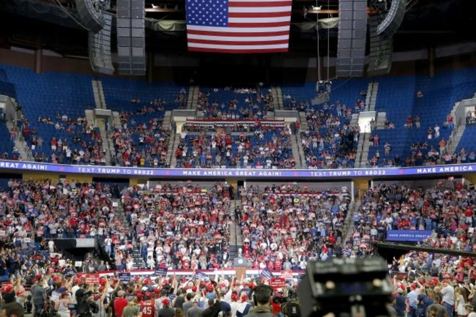 Photo -  President Donald Trump speaks to a small-than-expected crowd at a campaign rally at the BOK Center in Tulsa on Saturday. [Sarah Phipps/The Oklahoman]