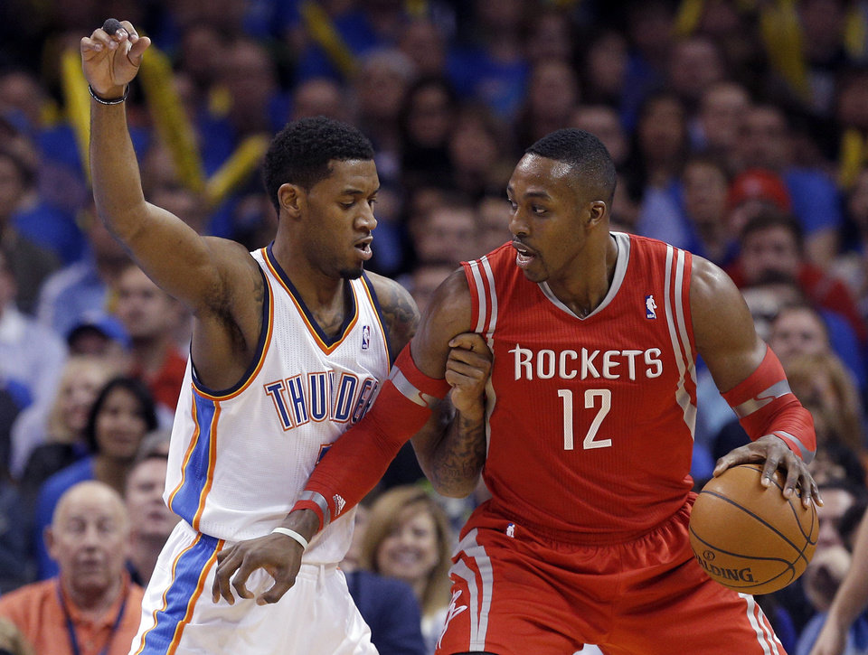 Photo - Oklahoma City's Perry Jones (3) defends against Houston's Dwight Howard (12) during the NBA game between the Oklahoma City Thunder and Houston Rockets at the  Chesapeake Energy Arena  in Oklahoma City, Okla., Tuesday, March 11, 2014. PHOTO BY SARAH PHIPPS, The Oklahoman